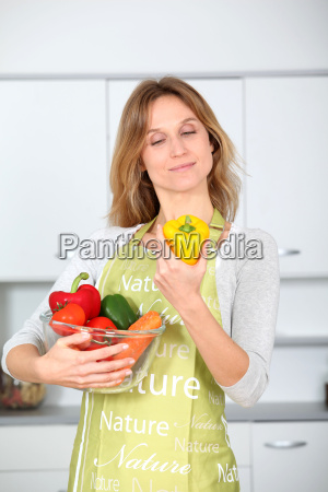 woman in kitchen ready to prepare