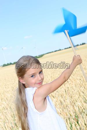 little girl holding blue swirl in