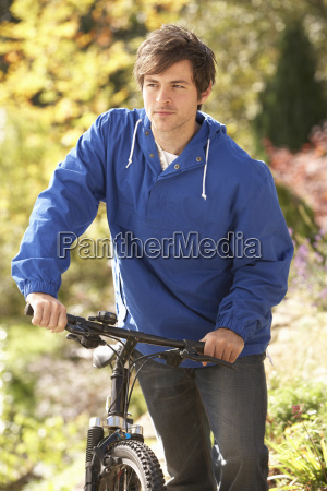 portrait of young man with cycle
