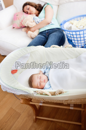 young mother sleeping on the sofa