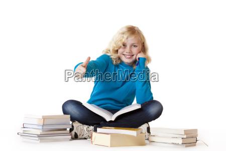 school girl showing thumbs