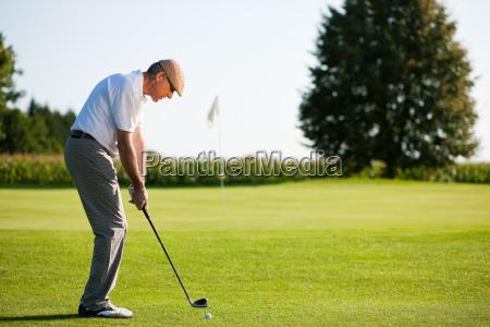 senior golfer in summer