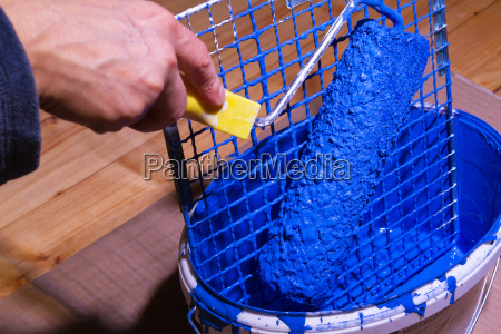 bucket with blue paint and grates