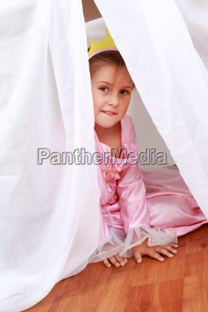 adorable girl playing hide and seek
