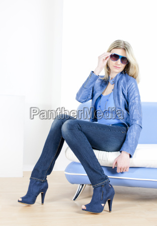 woman wearing blue clothes sitting on