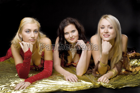 three young woman on gold