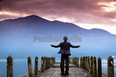 businessman stand on the pier