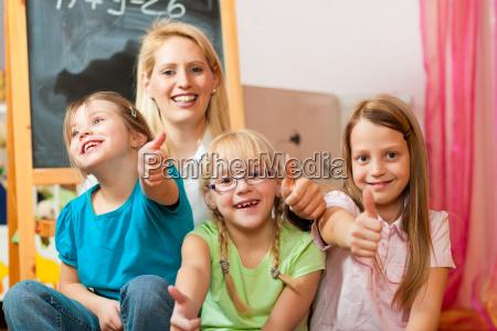 mother with her school children