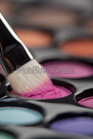 eyeshadow set with makeup brush picking