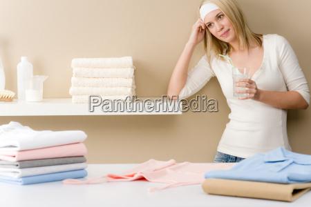 laundry ironing woman break with