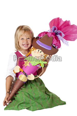 schoolgirl with treats sitting laughing happily