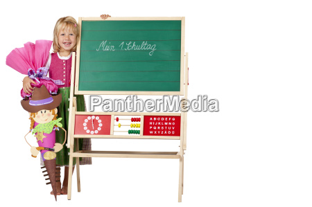 girl with schultuete happy next school