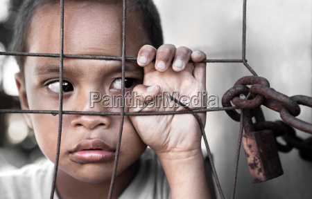 boy behind fence in philippines