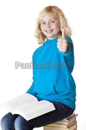 happy schoolgirl showing thumbs up