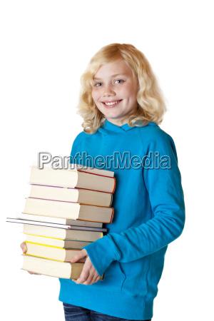 happy schoolgirl holds textbooks