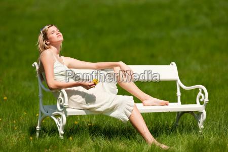 summer young woman relaxing bench