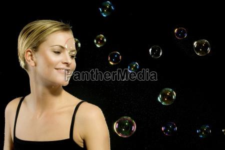 woman blowing bubbles
