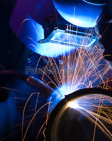 blue lit mig welder close