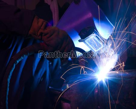 dramatic, blue-lit, mig, welding, close - 4403257