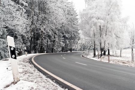 auto road through winter landscape