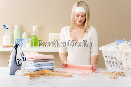 laundry ironing woman folding clothes