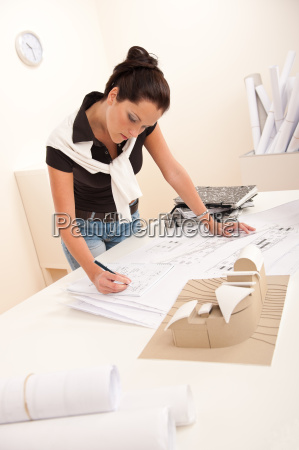 female architect at the office writing