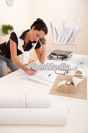 female architect busy at the office