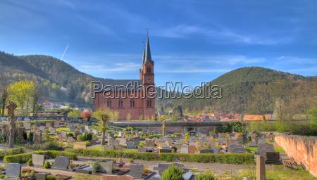 graveyard with church in pfalz germany