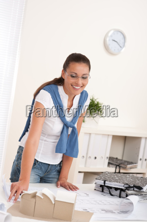 brown hair female architect at the