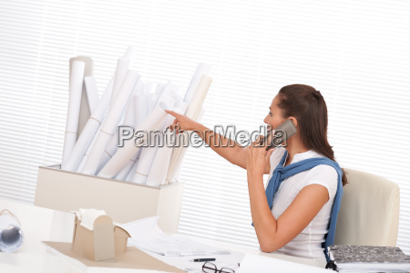 female architect calling with phone at