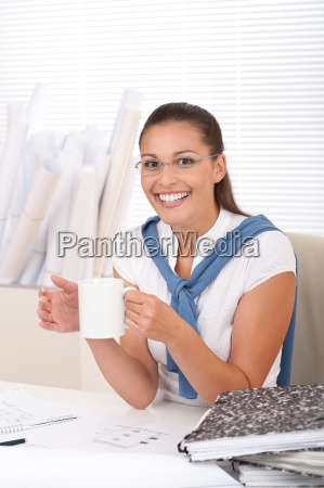 happy female architect with coffee