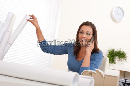 female architect on the phone sitting
