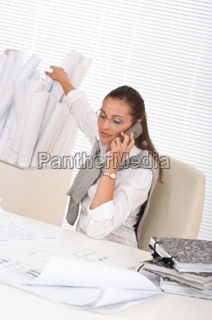 happy female architect on the phone