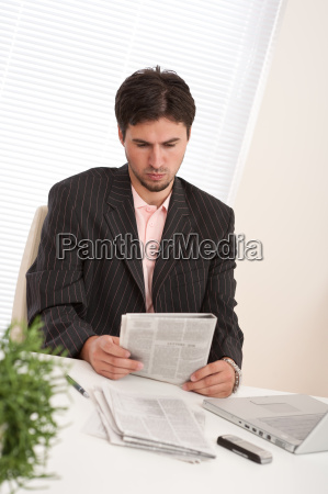 successful modern businessman with laptop and