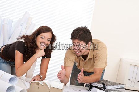 man and woman at architect office