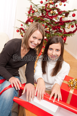 two woman packing christmas present