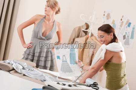 fashion model fitting dress by professional