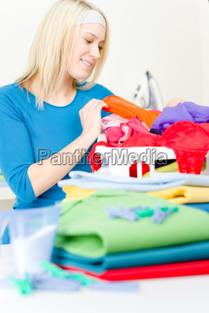 laundry woman folding clothes home