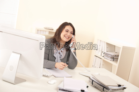 young executive woman talking on phone