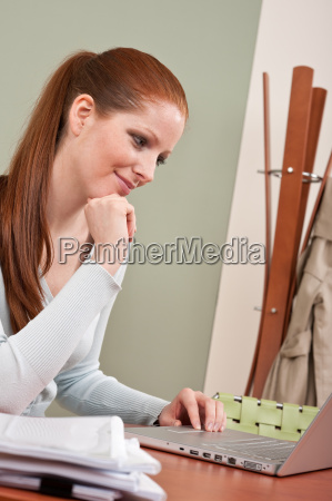 long red hair woman working at