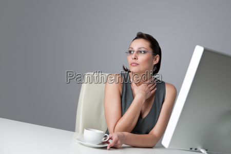thoughtful business woman at office with