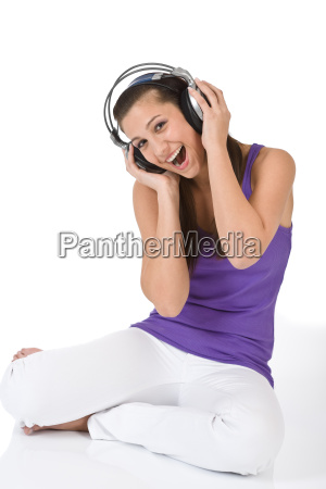 happy teenager woman enjoy music with