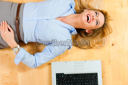 businesswoman at home on the floor