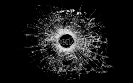 bullet hole in glass isolated on