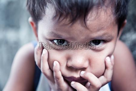asian boy portrait sad with
