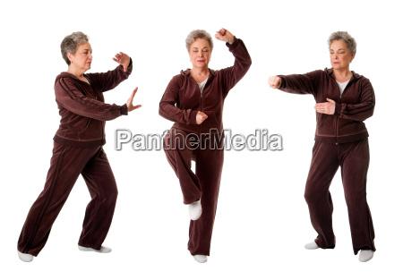 senior woman doing tai chi yoga