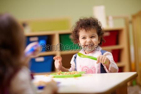 children eating lunch in kindergarten