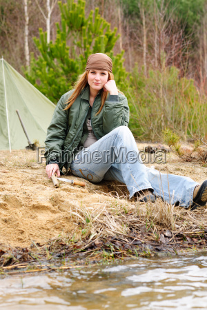 camping woman tent nature sitting stream