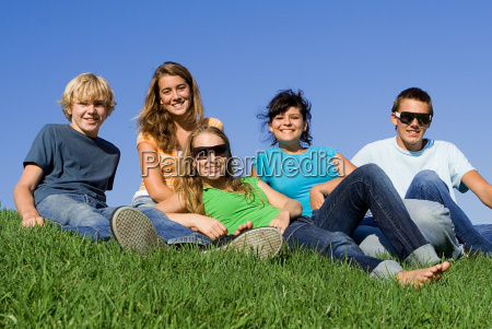 group of happy teens or students