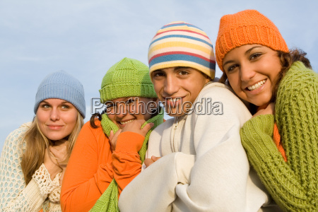 group of happy cold teens